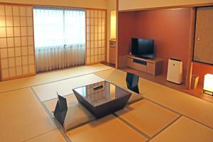A television and/or entertainment center at Karasuma Kyoto Hotel