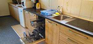 A kitchen or kitchenette at Ada Apartments