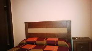 A bed or beds in a room at Hostal Patrón