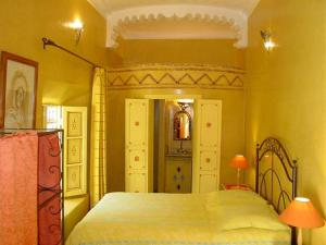 A bed or beds in a room at Riad Ker Saada