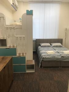 Кровать или кровати в номере Леон Отель