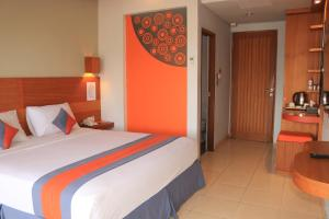 A bed or beds in a room at Grand Sinar Indah