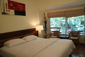 A bed or beds in a room at Palita Lodge