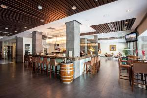 A restaurant or other place to eat at Norfolk Hotel Saigon