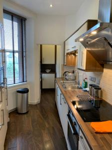 A kitchen or kitchenette at Howburn Residence