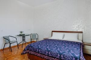 Кровать или кровати в номере Отель 21 Век