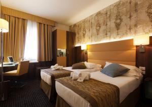 Letto o letti in una camera di Hotel Apogia Sirio Mestre