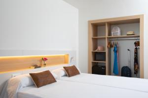 A bed or beds in a room at Prestige Sant Marc