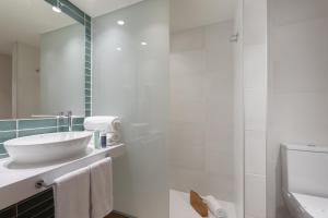 A bathroom at Prestige Sant Marc