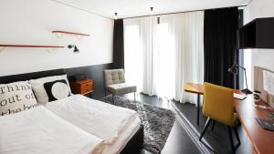 A bed or beds in a room at The SPOT - Serviced Apartments