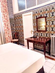 Cama o camas de una habitación en Hotel Simon