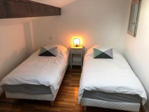 Un ou plusieurs lits dans un hébergement de l'établissement House 810