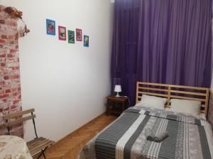 Кровать или кровати в номере Lorf Hostel&Apartments