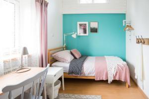 Łóżko lub łóżka w pokoju w obiekcie RowerowyFun