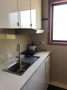 A kitchen or kitchenette at Classical 1bedroom Studio*Close to airport&CBD