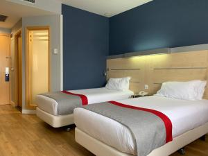 A bed or beds in a room at Holiday Inn Express Vitoria, an IHG Hotel