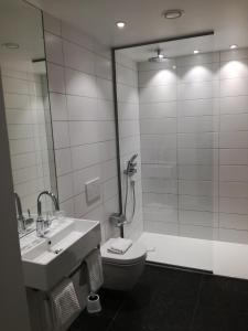 Ein Badezimmer in der Unterkunft Hotel Empire