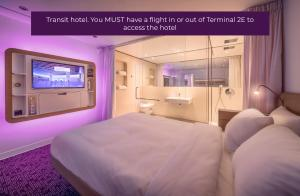 A bed or beds in a room at YOTELAIR Paris CDG - Transit Hotel - Terminal 2E