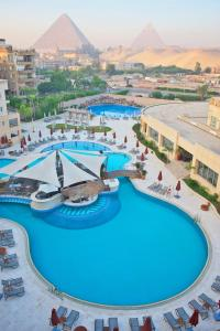 A view of the pool at Le Meridien Pyramids Hotel & Spa or nearby