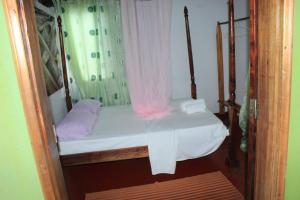 Ein Bett oder Betten in einem Zimmer der Unterkunft Mionga