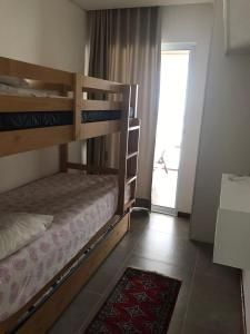 A bunk bed or bunk beds in a room at Varandas do Francês