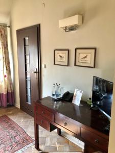 Telewizja i/lub zestaw kina domowego w obiekcie Villa Riccona