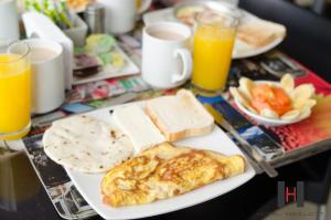 Breakfast options available to guests at Hotel Merlott 70