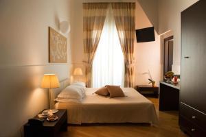Letto o letti in una camera di Palazzo Indelli