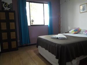 Ein Bett oder Betten in einem Zimmer der Unterkunft Aracari Garden Hostel