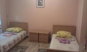 Кровать или кровати в номере Отель Золотой Улей