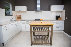 A kitchen or kitchenette at Little Paradise Aruba Vacation Apartments