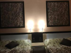 Кровать или кровати в номере Гостиница Сапун гора