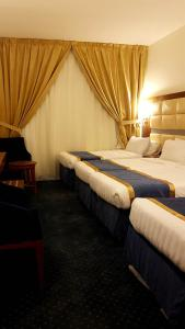 A bed or beds in a room at Mawaddah Al Safwa Hotel