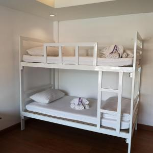 A bunk bed or bunk beds in a room at Korbua House