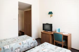 A bed or beds in a room at Vodnik Club