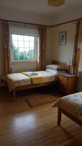 A bed or beds in a room at Kilcreeny Lodge