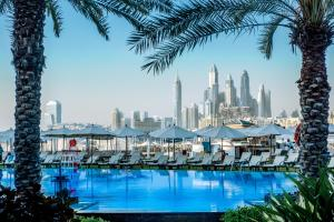 The swimming pool at or near Rixos The Palm Hotel & Suites -