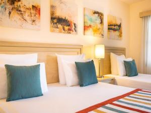 A bed or beds in a room at Paloma Grida Resort & Spa
