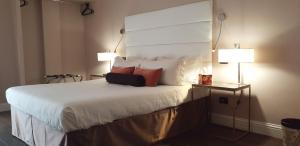 A bed or beds in a room at Althea Inn Roof Terrace
