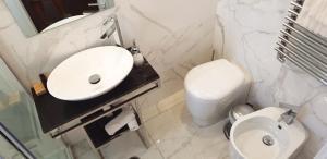 A bathroom at Althea Inn Roof Terrace