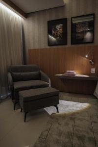A seating area at Oscar Hotel Executive