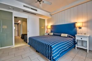 A bed or beds in a room at db Seabank Resort + Spa All Inclusive