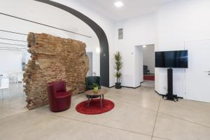 A television and/or entertainment center at Hotel Cascina Fossata & Residence