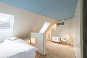 Ein Bett oder Betten in einem Zimmer der Unterkunft Hotel Dom