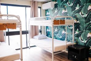 A bunk bed or bunk beds in a room at Waikiki Beachside Hostel