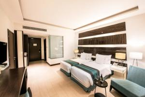 A bed or beds in a room at Welcomhotel by ITC Hotels, Dwarka, New Delhi