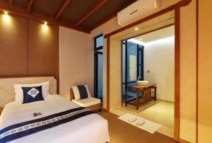 The One Resortにあるベッド