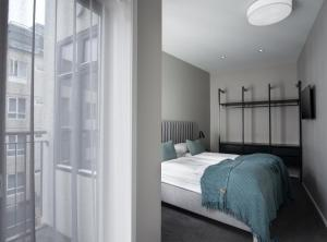 A bed or beds in a room at Reykjavik Residence Apartment Hotel