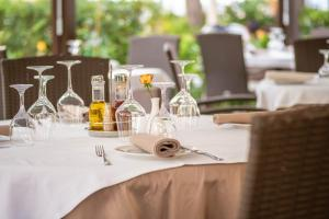 A restaurant or other place to eat at Boutique Hotel Villa Pattiera