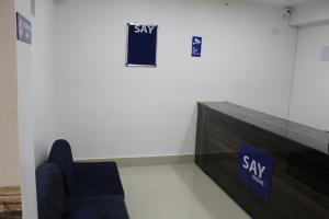 The lobby or reception area at Say Rooms Hotel Riddhi Siddhi